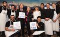الأمين العام للأمم المتحدة يزور مطعما تديره مجموعة من اللاجئين والنمساويين